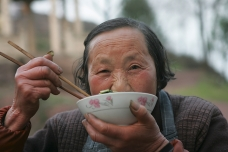 Old woman eating, Yiwu, China